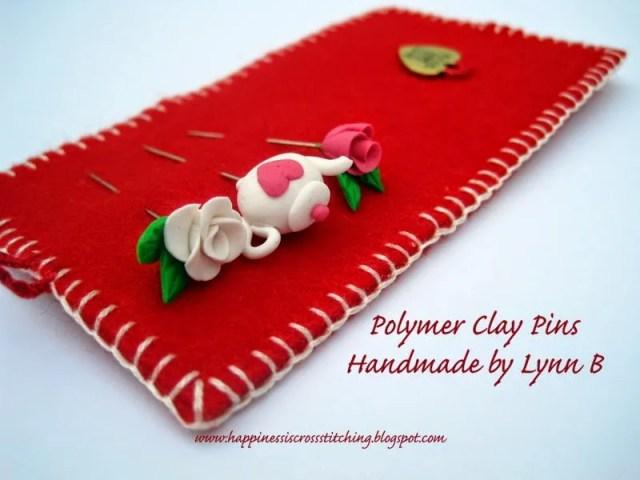 Polymer clay pins designed by Lynn B