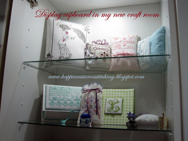 My craft room display cupboard www.happinessiscrossstitching.blogspot.com