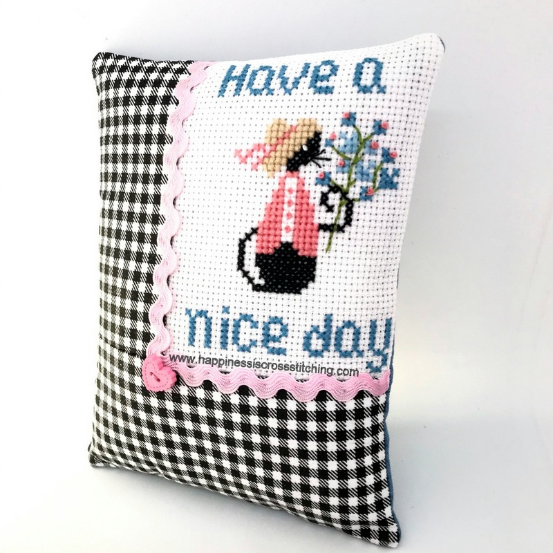 Have a Nice Day Mini Cat cross stitch pattern, small black cat holding a bunch of flowers.