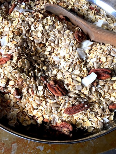 Oats in the bowl, mixed with sea salt, cinnamon, brown sugar, nuts, seeds, coconut