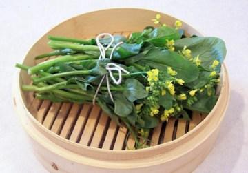 flowering choy sum in steamer basket