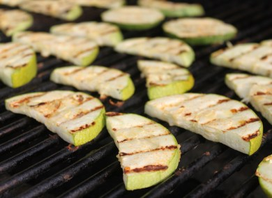 grilling slices of Tatume squash