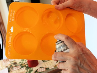 spraying silicone mold with oil before pouring