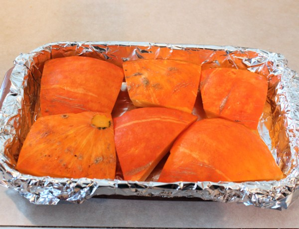 pumpkin cut up and ready for roasting