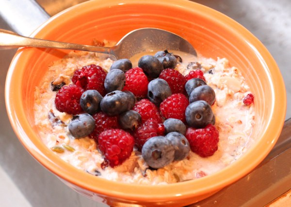 muesli with fresh raspberries and blueberries