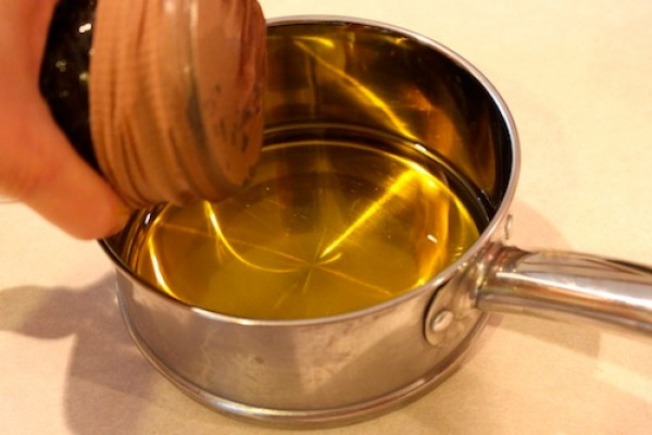 straining oil using nylon hose