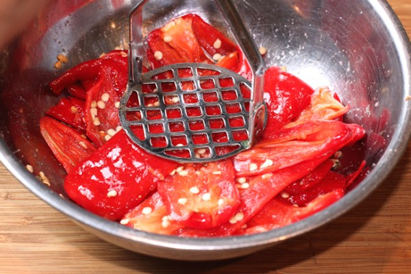 mashing the pepper and salt mixture