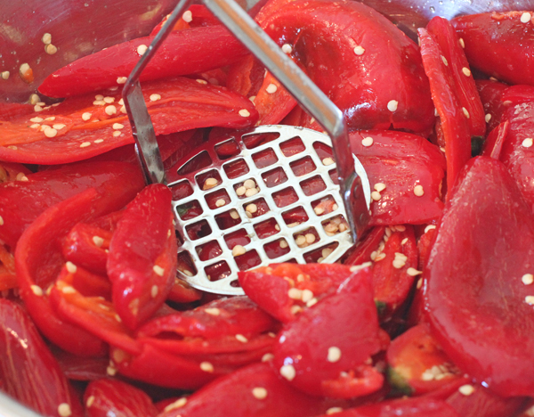 mashing peppers for fermenting