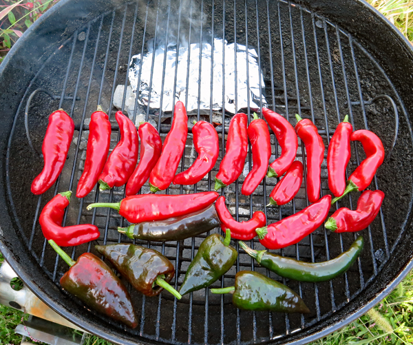 peppers smoking on the grill