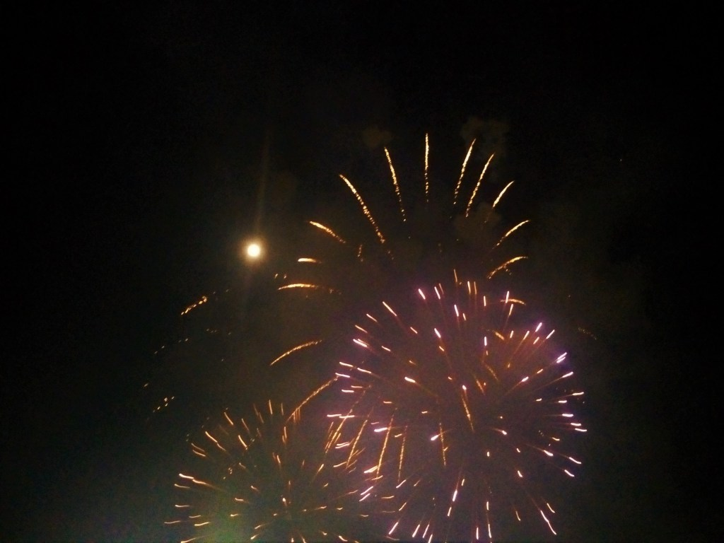 The party ends with fireworks bursting under a full moon