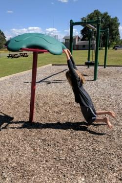 Kira enjoyed the whirligig equipment. Holding on is tough!