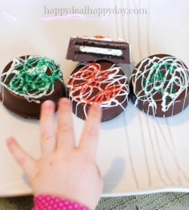 Chocolate Covered Oreos - Christmas Version! Here is a great step-by-step tutorial to make these beautiful and rich cookies! They look much more difficult to make than they are - very easy to do and make a great gift!!!! toddler photo bomb!
