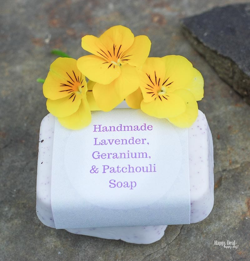 Homemade Soap with Essential Oils - Lavender, Geranium, and Patchouli Scented picture on rock with flowers