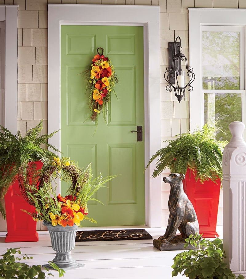Colorful floral swag on green door