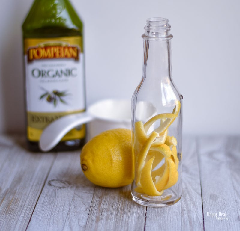 place lemon peels inside bottle of lemon infused olive oil