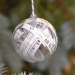"""A clear Christmas ornament with the song, """"O Come, All Ye Faithful"""" inside."""