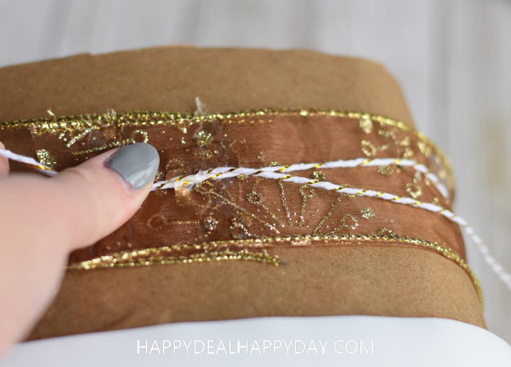 how to upcycle an Oxiclean tub into Christmas Gift wrapping idea