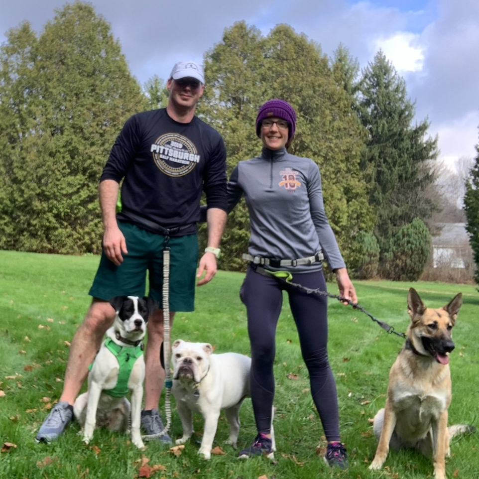 Runners Joe Steph and their dogs