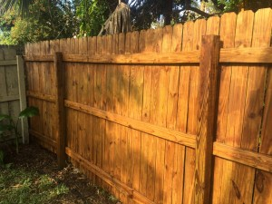 Cleaning an outdoor fence by Happy Family Blog