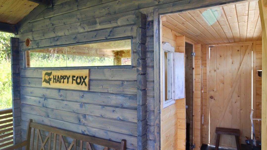 Happy-Fox-Floating-Sauna-and-Swimming-in-the-Ounasjoki-river-floating-sauna-inside