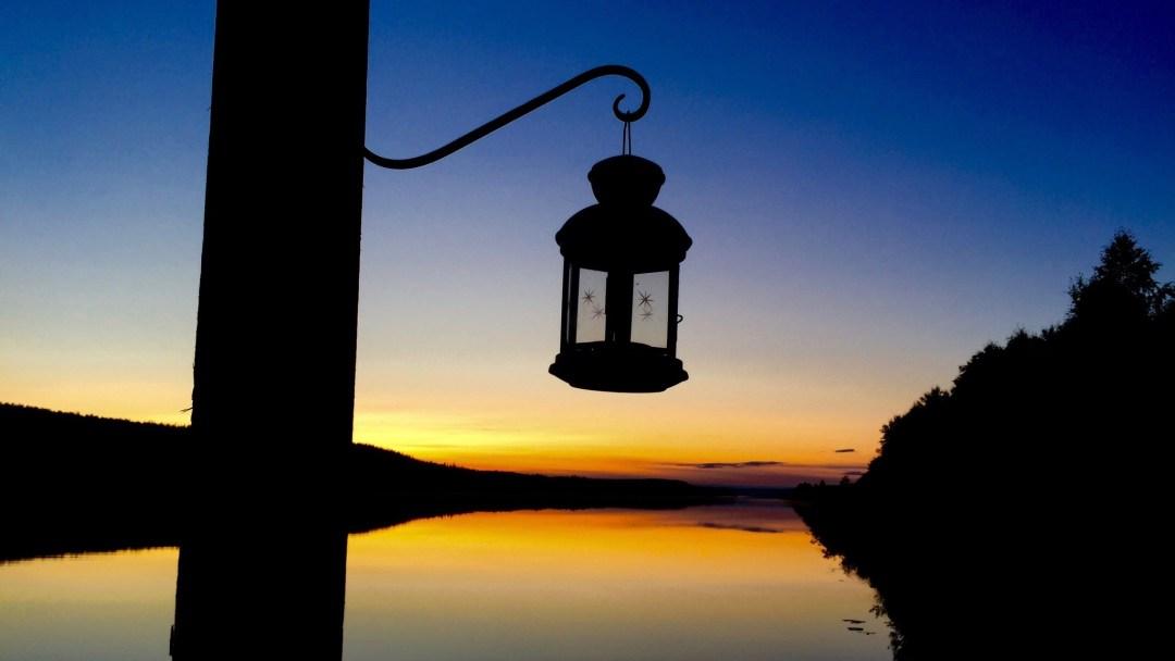 Happy-Fox-Floating-Sauna-and-Swimming-in-the-Ounasjoki-river-sunset