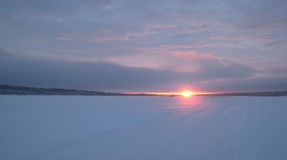 Happy-Fox-Arctic-reindeer-adventure-sunset-at-ounasjoki-river