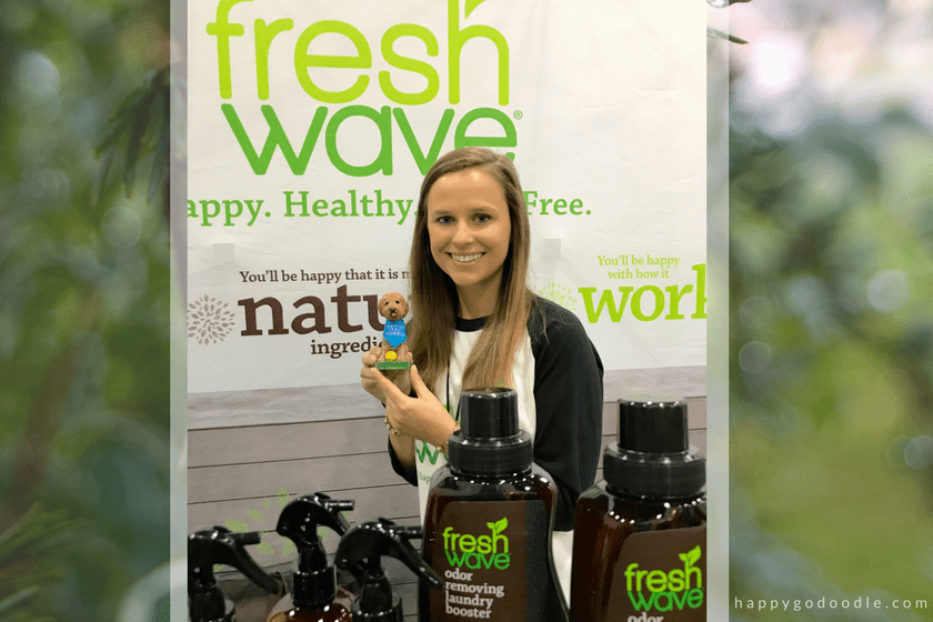 Girl holding bobblehead dog at the Fresh Wave booth during the BlogPaws conference
