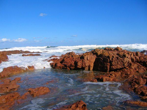 waves crashing on rocks at Wilderness Coast Mallacooota