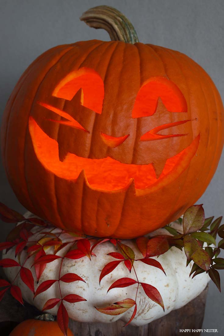 jack-o-lantern on white pumpkin