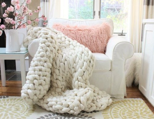 Arm knit a chunky throw in about 90 minutes. All you need is yarn and your arms and you can make this beautiful 100% wool blanket.