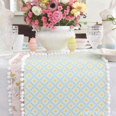 This unique paper table runner is easy to make and cute. It would dress up any table either at home or at a wedding. Make this inexpensive craft in minutes.
