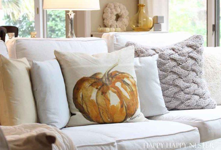 orange pumpkin water colored on a beige pillow