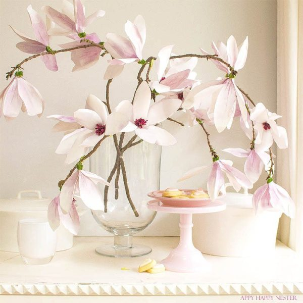 These magnolia flowers look so real. This paper flower tutorial you won't want to miss. I made this flower out of watercolor flower petals and added them to a tree branch, and you have lifelike flowers that you can make from paper. #DIY   #paperflowers   #crafts   #fauxflowers