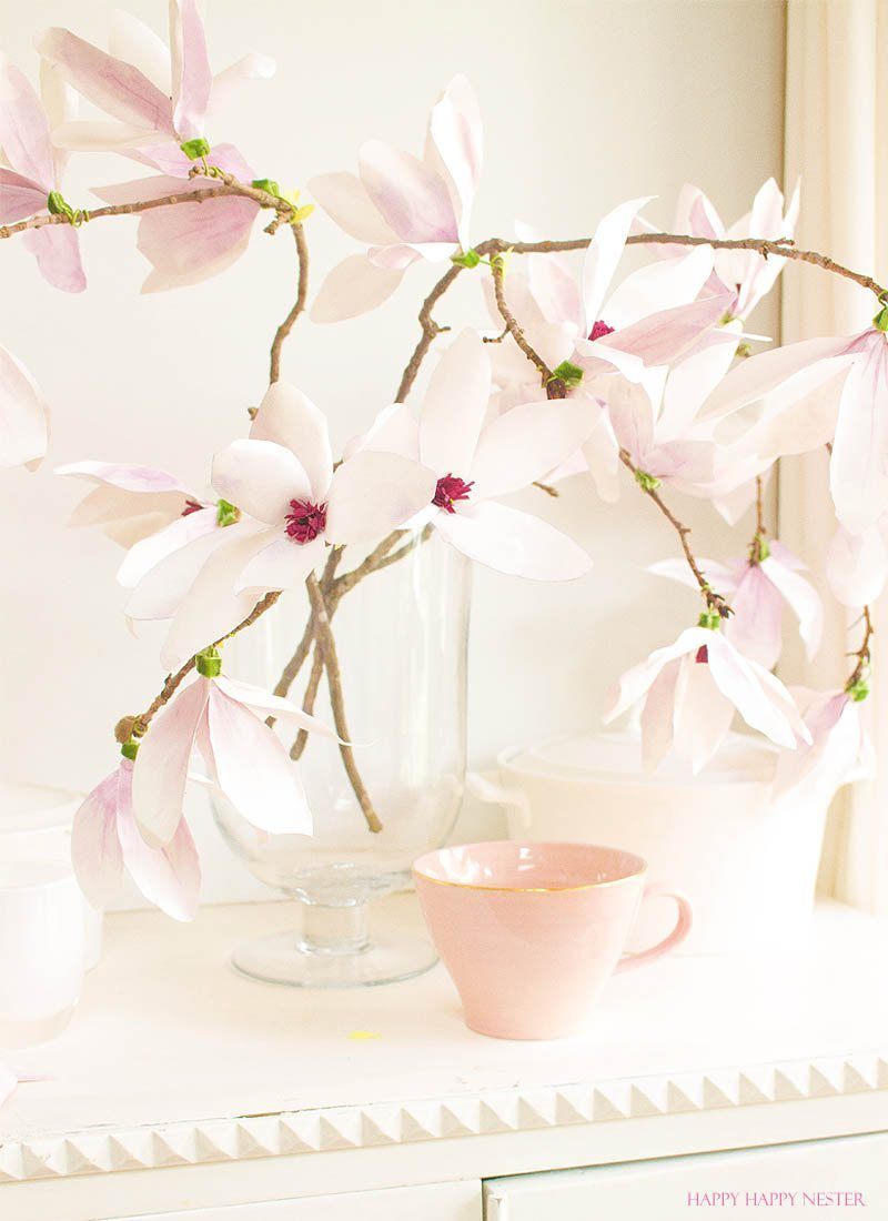 A magnolia paper flower tutorial you won't want to miss. I made this flower out of watercolor flower petals and added them to a tree branch, and you have lifelike flowers that you can make from paper. #DIY | #paperflowers | #crafts | #fauxflowers