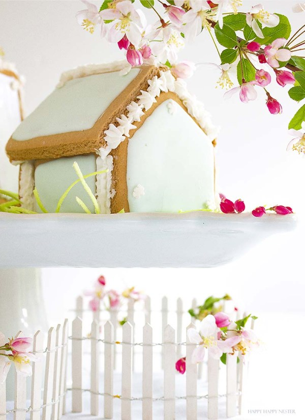 These adorable Easter Houses are perfect for spring. Make them from the mini-gingerbread kit, and you'll love this easy project. Place them on a cake stand and use them on your Easter or Spring table. Decorate them with icing and fun candies. You and your family will love this project. #spring #easter #diy #crafts
