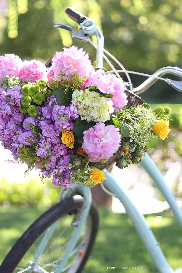 floral bouquet in a bike basket