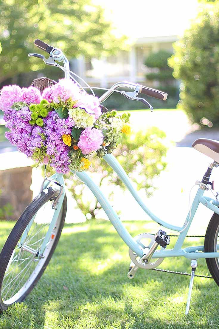 aqua cruiser bike with basket of flowers