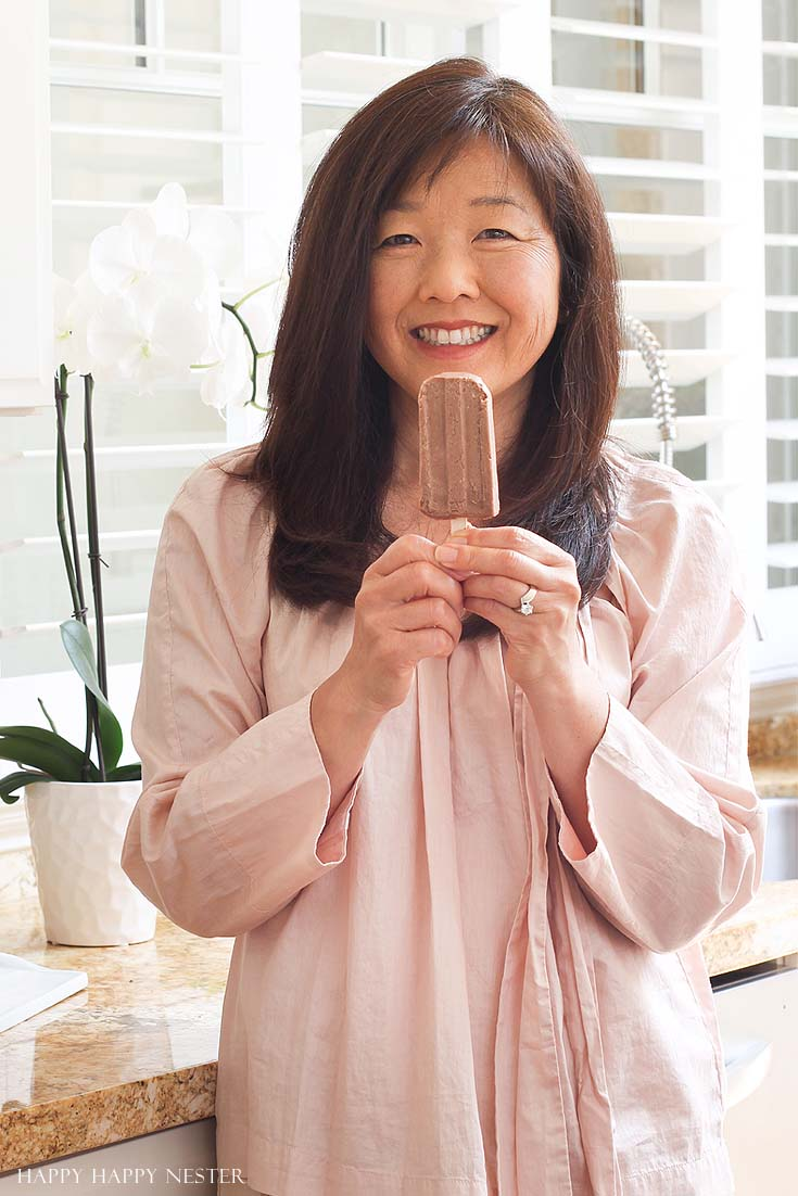 woman holding a chocolate popsicle