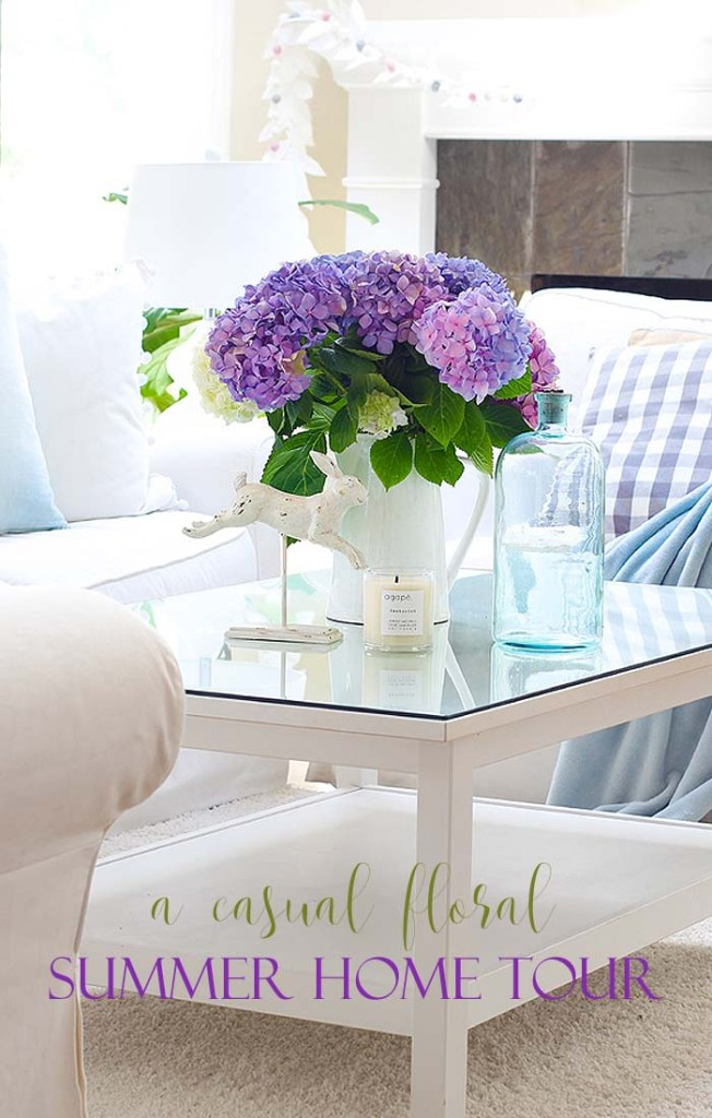 pinterest image with a white living room and purple flowers