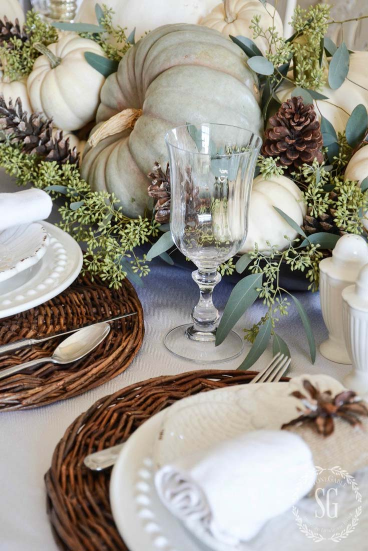 Green and white pumpkin as a centerpiece on a white table