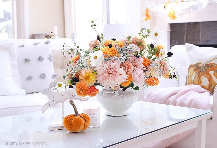 bouquet of fresh flowers on a white table in a white living room