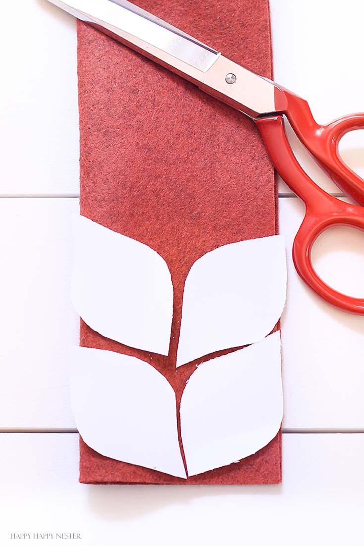 red felt with four leaf patterns placed on felt