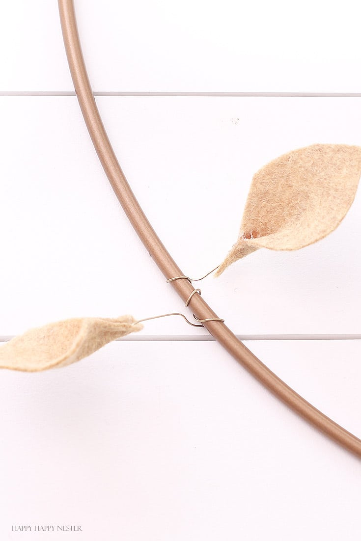 two tan leaf attached to wire