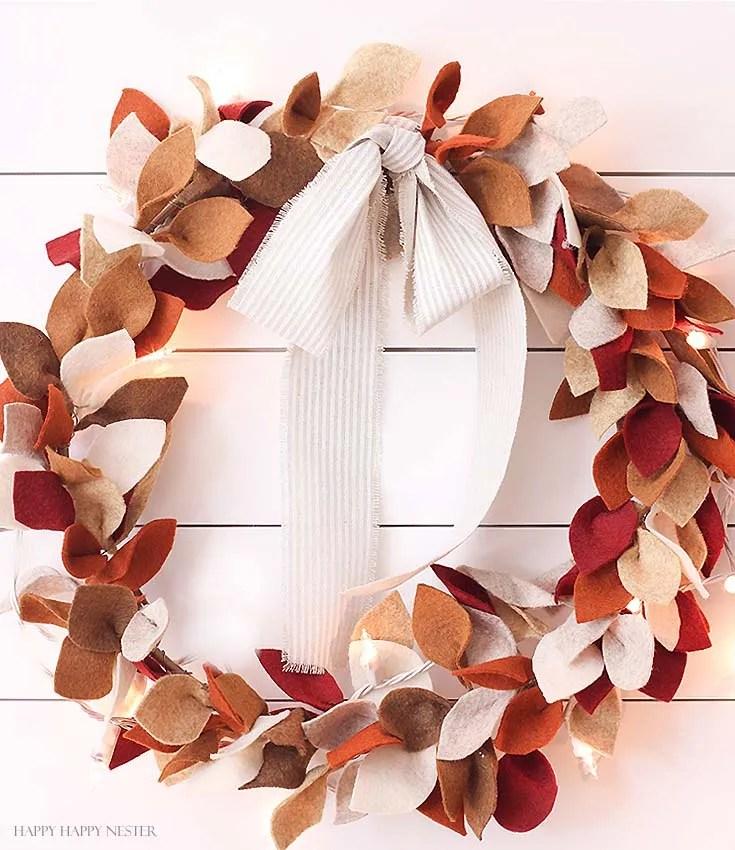 felt leaf wreath with twinkle lights on white wall