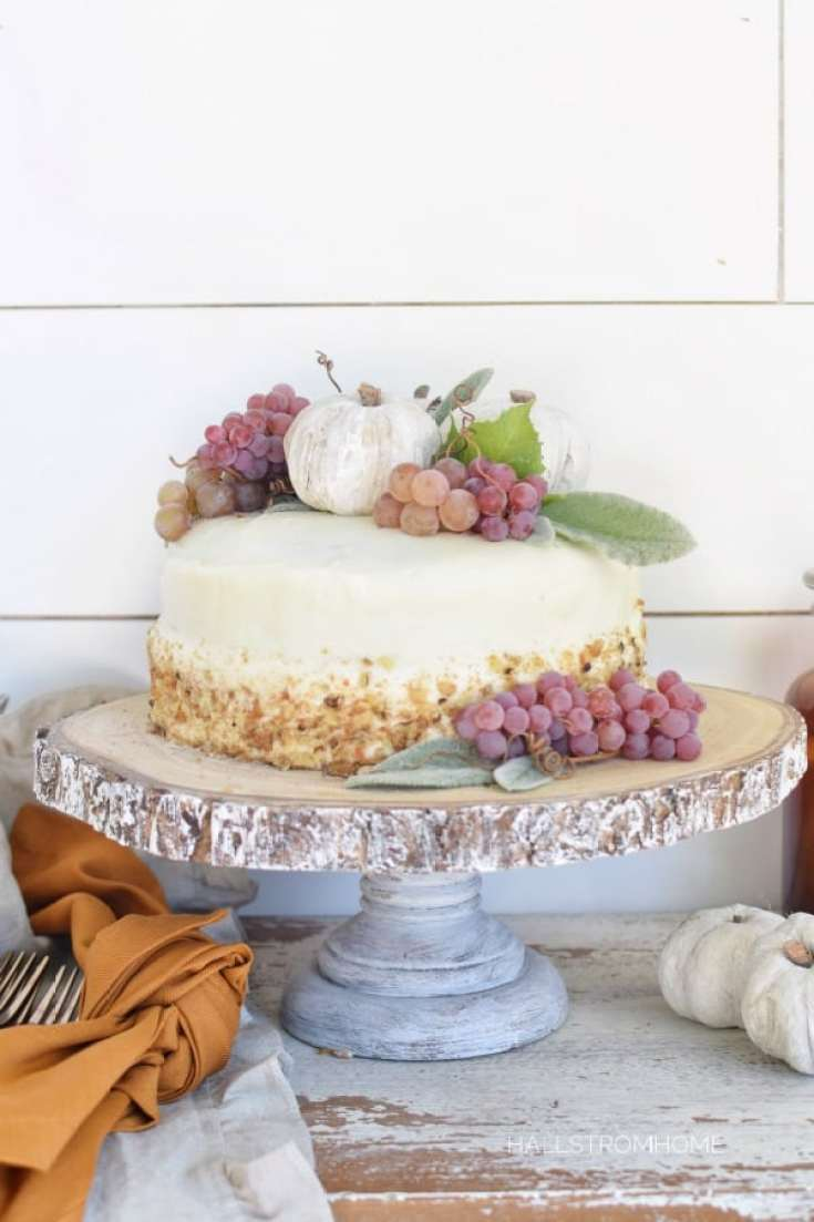 Pumpkin spice cake on a wooden cake stand