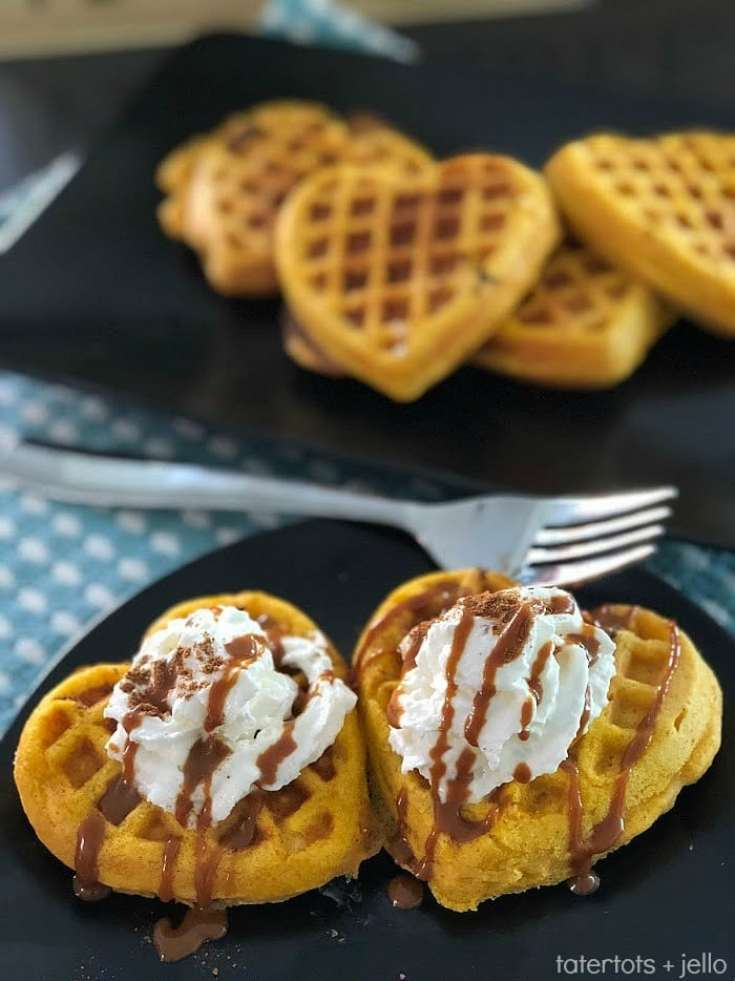 heart shaped pumpkin waffles on blue and white checkered table cloth