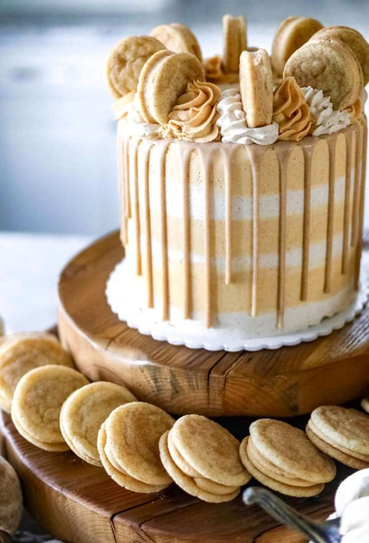 a pumpkin cake with cookies on the top