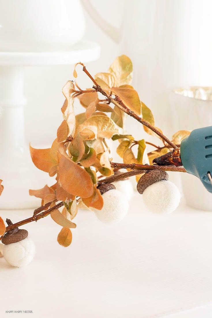 How to Make a Felt Acorn Branch use a glue gun