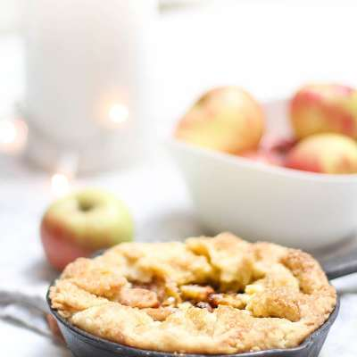 My mini apple tart recipe is baked in a mini cast iron pans. The pans create a crispy crust that is better than the typical apple pie. This apple dessert is similar to a rustic apple tart recipe but it has a scrumptious custard addition. #appletart #desserts #baking #miniappletart #applepie