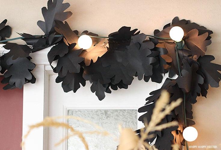 black leaf garland with white lights